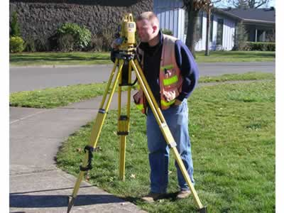surveyor in the field with transent